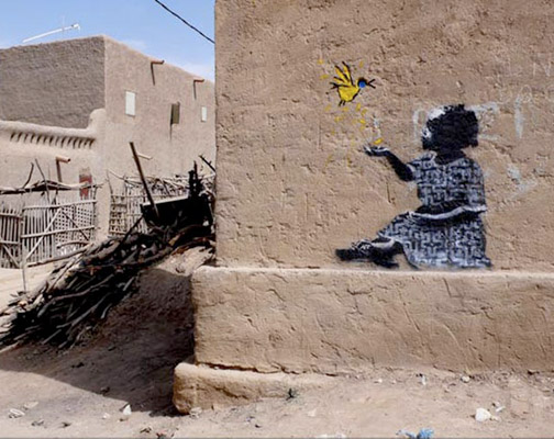gradientmagazine.com_2009_07_new-work-by-bansky-spotted-in-africa_artist-banksy-new-pieces-mali-04